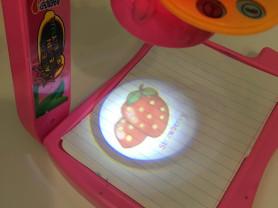 Игрушка проектор