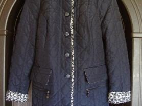 Почти новая, стеганная, женская куртка 46-48р.
